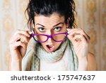 surprised woman looking over... | Shutterstock . vector #175747637