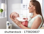 happy young mother holding... | Shutterstock . vector #175820837