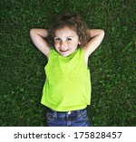 a young girl laying in the grass | Shutterstock . vector #175828457