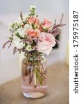 mason jar of roses  table... | Shutterstock . vector #175975187