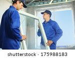 two workers in blue work... | Shutterstock . vector #175988183