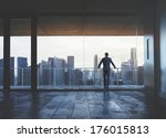 businessman looking at city | Shutterstock . vector #176015813
