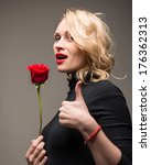 Elegant Woman With Red Rose