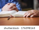 bible and praying hands | Shutterstock . vector #176398163
