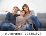 happy family of three relaxing... | Shutterstock . vector #176501927