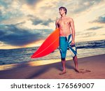 surfer on the beach at sunset... | Shutterstock . vector #176569007