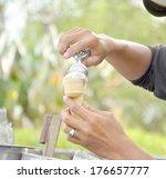 hands preparing cone ice cream... | Shutterstock . vector #176657777