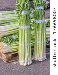 Small photo of Closeup of a fresh bunch of leek at the farmers market, Allium ampeloprasum background
