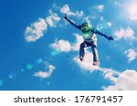 snowboarder making jump high in ... | Shutterstock . vector #176791457