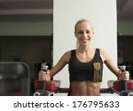 fitness woman with smiling face.... | Shutterstock . vector #176795633