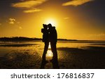 couple at sunset | Shutterstock . vector #176816837