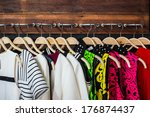 Many Blouses On Hangers In The...