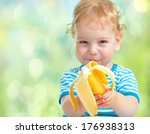 Happy Kid Eating Banana Fruit....