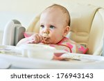 first meal of six months baby... | Shutterstock . vector #176943143