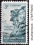 Small photo of UNITED STATES OF AMERICA - CIRCA 1955: A stamp printed in USA shows Old man of the mountains, New Hampshire, Live Free or Die, circa 1955