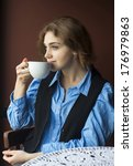 woman enjoying coffee | Shutterstock . vector #176979863