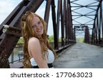 beautiful young girl on bridge. | Shutterstock . vector #177063023