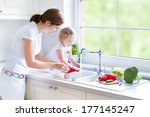 young beautiful mother and her... | Shutterstock . vector #177145247