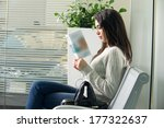 young woman reading brochure... | Shutterstock . vector #177322637