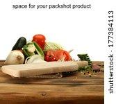 wooden desk of vegetables and...