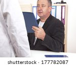doctor talking with man in the... | Shutterstock . vector #177782087