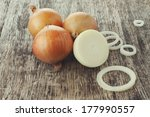 White Onions On A Cutting Board