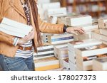 Woman Holding Books At A...