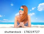 redhead girl on the beach in... | Shutterstock . vector #178219727