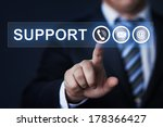 Small photo of business, technology, internet and networking concept - businessman pressing support button on virtual screens