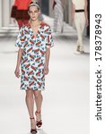 Small photo of NEW YORK - FEBRUARY 10 2014: Othilia Simon walks the runway during Carolina Herrera fall 2014 fashion show at New York Mercedes - Benz Fashion Week