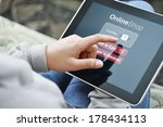 young woman using touch screen... | Shutterstock . vector #178434113
