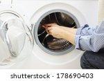 handyman repairing a washing... | Shutterstock . vector #178690403