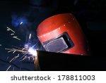 worker welding steel with sparks | Shutterstock . vector #178811003