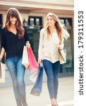 two happy young women shopping... | Shutterstock . vector #179311553