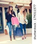 two happy young women shopping... | Shutterstock . vector #179311577