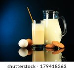 eggnog with milk and eggs on... | Shutterstock . vector #179418263