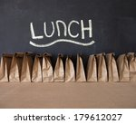 a row of brown bags against a... | Shutterstock . vector #179612027