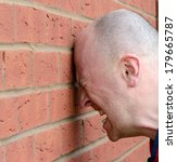 a man banging his head against... | Shutterstock . vector #179665787