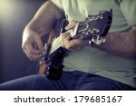 close up on man s hand playing... | Shutterstock . vector #179685167