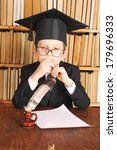 Small photo of Unusual joky parody. Child as a professor with quill and paper in library