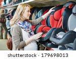 woman choosing child car seat... | Shutterstock . vector #179698013