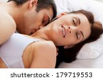 Stock photo i love him kissing me beautiful young loving couple having sex while lying in bed 179719553