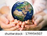 family holding earth in hands.... | Shutterstock . vector #179954507