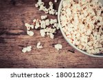 a bowl of popcorn on a wooden... | Shutterstock . vector #180012827
