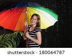 teenage girl sheltering from... | Shutterstock . vector #180064787