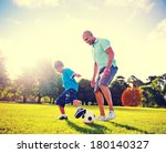 Father And Son Playing Ball In...