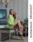 beautiful young woman sitting... | Shutterstock . vector #180164327