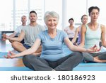 sporty people sitting in lotus... | Shutterstock . vector #180186923
