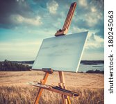 Blank Canvas Rests On A Easel...