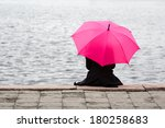 Woman Sitting Lonely With Pink...